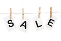 Message on clothespin sale held by Stock Photography
