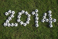 Message for made with football soccer balls small on green grass Royalty Free Stock Image