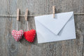 Message and red hearts on the clothesline against wooden background Royalty Free Stock Image