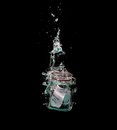 Message in sinking bottle on paper a to the bottom of the sea with bubbles Royalty Free Stock Photography
