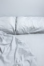 Messy bed with gray bedclothes Royalty Free Stock Photography