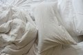 Messy bedding close up of sheets and pillow Royalty Free Stock Photos