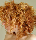Messy curly red hair