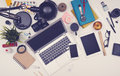 Messy desk responsive hero header top view of with smartphone computer tablet and other office items of mockup Stock Photos