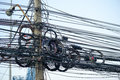 Messy electrical cables and wires on electric pole Royalty Free Stock Photo