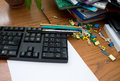 Messy office desk business still life conceptual shot of with a keyboard a paper and other documents and books Royalty Free Stock Photo