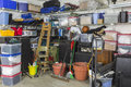 Messy packed garage residential full of junk and storage Stock Photography