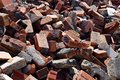 Messy pile of bricks background jagged red and debris Stock Photo