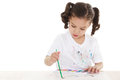 Messy preschooler stock image of female playing with watercolors over white background Royalty Free Stock Images