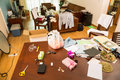 Messy room living with clothes and other stuff Royalty Free Stock Image