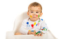 Messy toddler boy with paints sitting in a high chair Stock Images