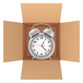 Metal alarm clock inside a cardboard box Royalty Free Stock Photo