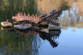 Metal aquatic garden sculpture alligator on rocks in an pond Stock Images