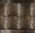 Metal armour background with rivets rusty Stock Image