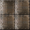Metal armour background with rivets rusty Stock Photos