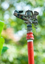 Metal automatic water sprinkler in the garden Stock Photos