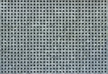 Metal background with square holes. Gray and bluish steel texture.