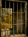 Metal bars in the old window Royalty Free Stock Photo