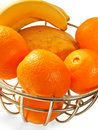 Metal  basket with orange fruits isolated Royalty Free Stock Image