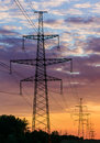 Metal Bearing high voltage power line during sunset or sunrise Royalty Free Stock Photo