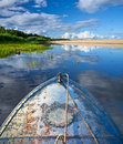 Metal boat on the lake prow of beautiful with summer clouds Royalty Free Stock Photos