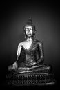 Metal Buddha statue full in black and white Royalty Free Stock Photo