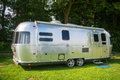 Metal caravan for holidays on campsite Royalty Free Stock Images