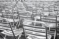 Metal chairs in rows black and white background. Royalty Free Stock Photo