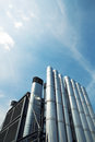 Metal chimneys against clear blue sky Royalty Free Stock Photo