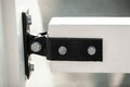 Metal clamp fixing two white wooden boards on bridge Royalty Free Stock Photo