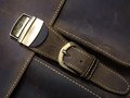 Metal clasp on leather case brass old with hand stitching Royalty Free Stock Photo