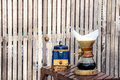 Metal coffee grinder and drip glass pitcher Royalty Free Stock Photo