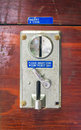 A metal coin slot panel from a coin operated machine Royalty Free Stock Photo
