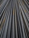 Metal construction rods folded in a row. A lot of bars for reinforcement of concrete structures Royalty Free Stock Photo