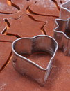 Metal cookie cutters and dough for gingerbread Royalty Free Stock Photo