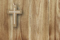 Metal cross on a wooden background of beige wood Royalty Free Stock Photo