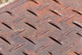 Metal drain cover pattern rusty Royalty Free Stock Photo