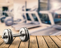 Metal dumbbell with gym background Royalty Free Stock Photo