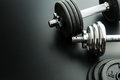 The metal dumbbell and weights. Royalty Free Stock Photo