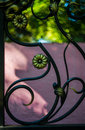 Metal fence ornament element with swirly bokeh background Stock Photos