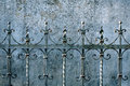 Metal fence and a wall Royalty Free Stock Images