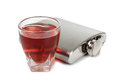 Metal flask whiskey flat and glass on white background Royalty Free Stock Photo