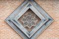 metal flower on orange bricks Royalty Free Stock Photo