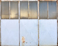 Metal garage door painted blue Royalty Free Stock Photo