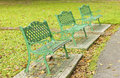 Metal garden chair in beautiful garden stock photo Royalty Free Stock Photography