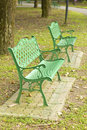 Metal garden chair in beautiful garden stock photo Stock Photos