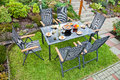 Metal garden furniture the by the house and the pool Royalty Free Stock Image