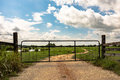 Metal gate on dirt road Royalty Free Stock Photo