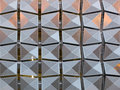 Metal geometric angular cladding on a generic modern building Royalty Free Stock Photo