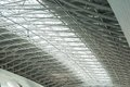Metal and glass roof of a huge empty hangar Royalty Free Stock Photo